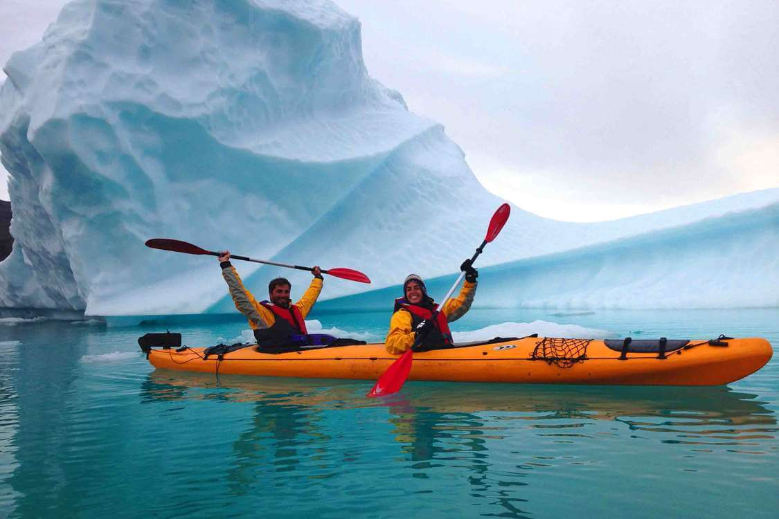 Two kayakers on a sea expedition through icebergs in South Greenland. Photo by Tasermiut South Greenland Expeditions, Visit Greenland