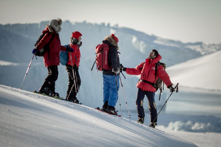 Marc Carreras from PGI Greenland with guests at the edge of the Ilulissat ice fjord in Greenland. By Mads Pihl