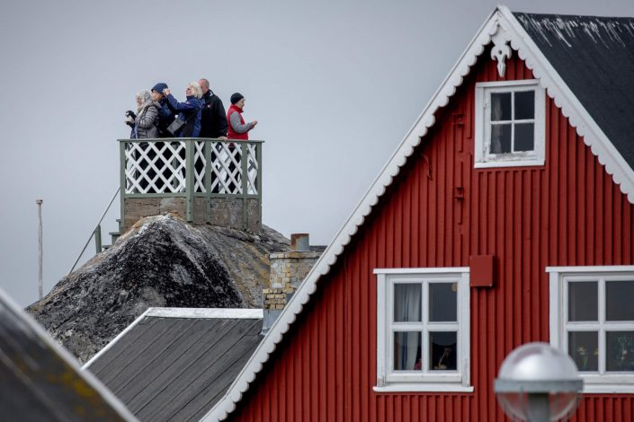 Cruise guests in a viewing tower on a rock in Nanortalik in South Greenland. Photo by Mads Pihl - Visit Greenland