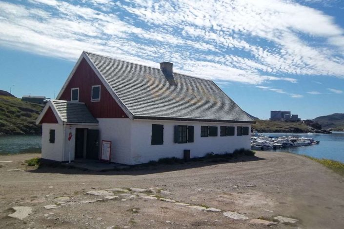 Entrance view of Narsaq Museum located in South Greenland in Summer. Photo by Narsaq Museum