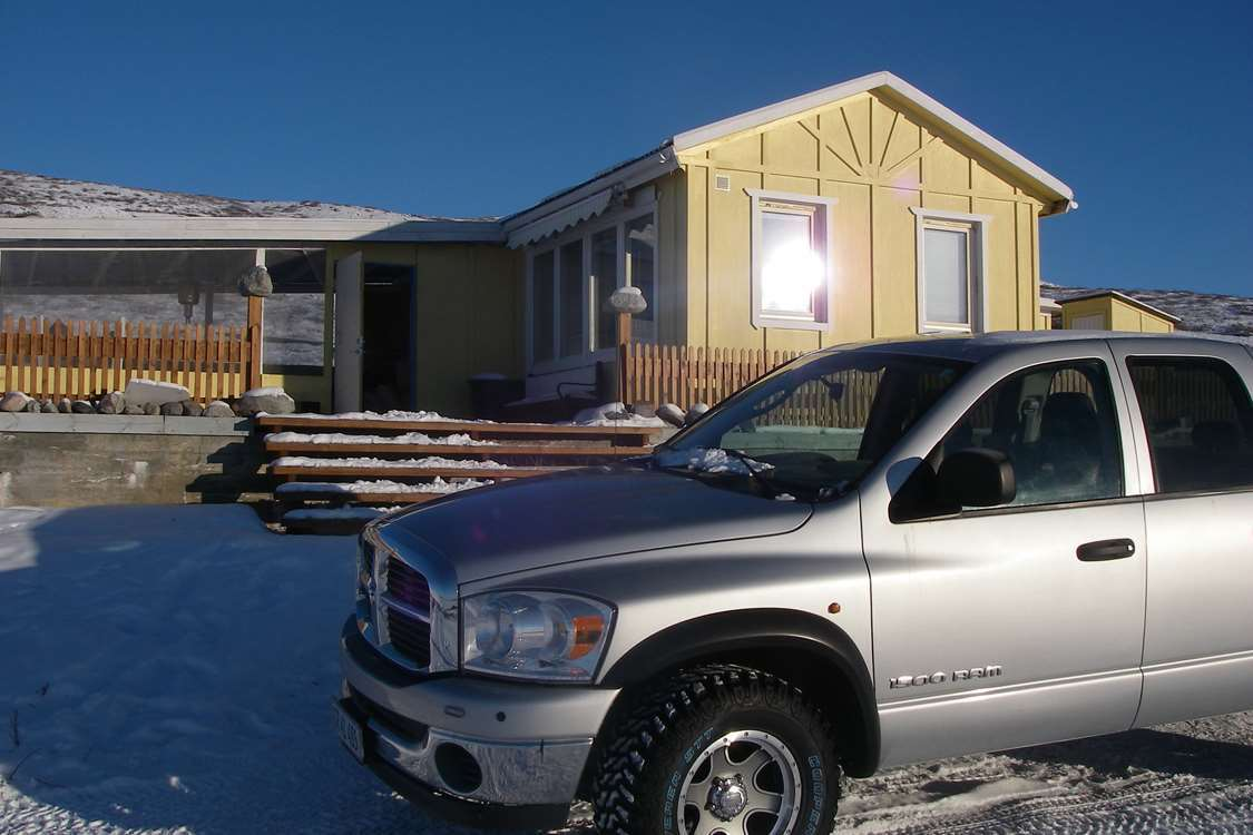 Truck in front of North Safari office and shop in Kangerlussuaq, Greenland. Photo by North Safari Outfitters