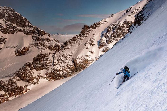 Skiing downhill offpist on a Sunny day in East Greenland. Photo by Pirhuk - Greenland Expedition Specialists
