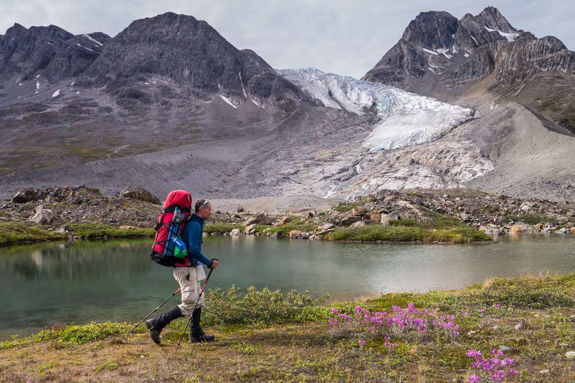 Hiker in Summer landscape in East Greenland. Photo by Pirhuk - Greenland Expedition Specialists