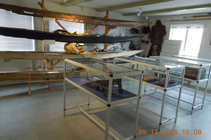 Inside view of Qaqortoq Museum with old Inuit relics - kayaks, hunting gear and cutlery. Photo by Qaqortoq Museum