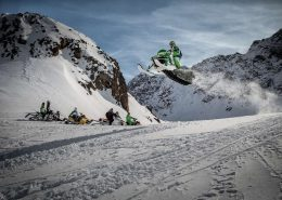Jumping snowmobiler on snowmobil expedition in Sisimiut. Visit Greenland