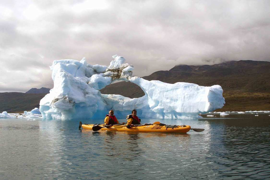Two people kayaking among icebergs near Tasermiut. Photo by Tasermiut South Greenland Expeditions, Visit Greenland