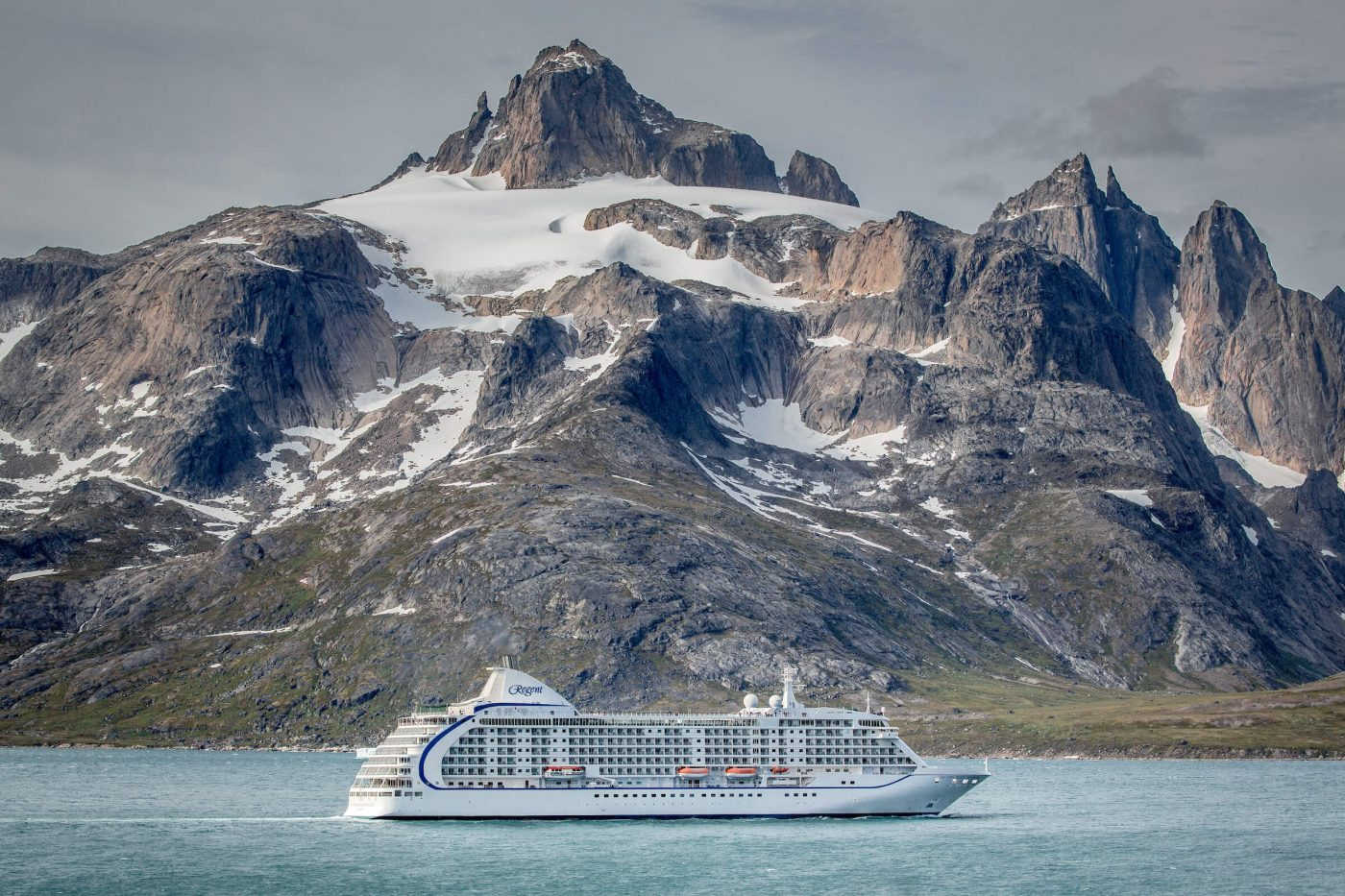 The cruise ship Sevens Seas Voyager passes underneath the mountain Qilertiki in South Greenland near Aappilattoq and Prince Christian Sound