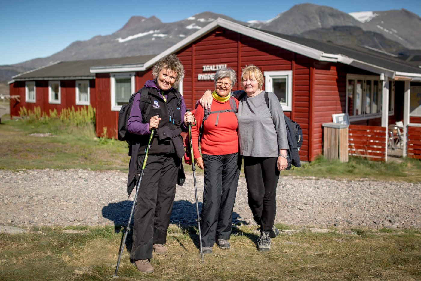Three female hikers at Igaliku Country Hotel in South Greenland. By Mads Pihl