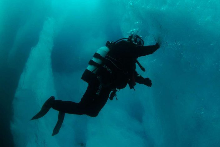 Diver exploring East Greenland from underwater. Photo by Arctic Dream, Visit Greenland