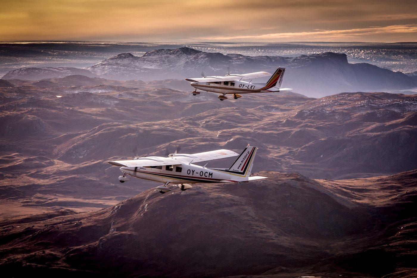 Two Air Zafari planes heading towards the Greenland Ice Sheet near Kangerlussuaq Airport