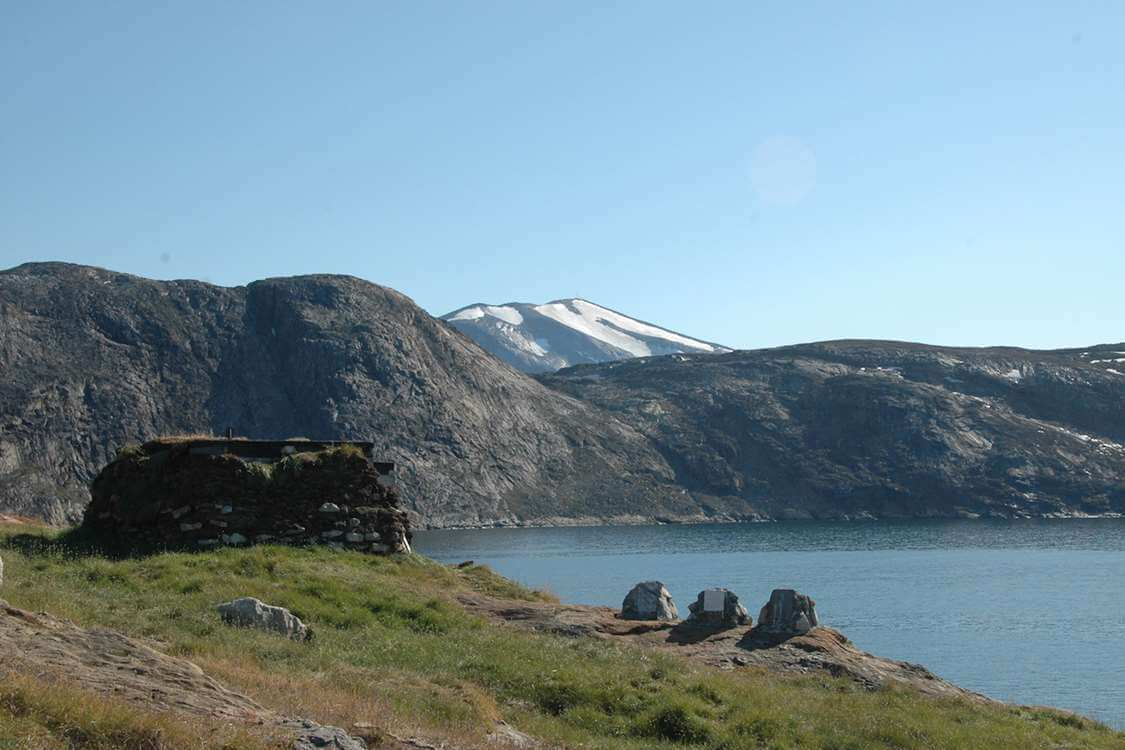 Waterfront and mountains infront of the Upernavik Museum. Photo by Upernavik Museum, Visit Greenland