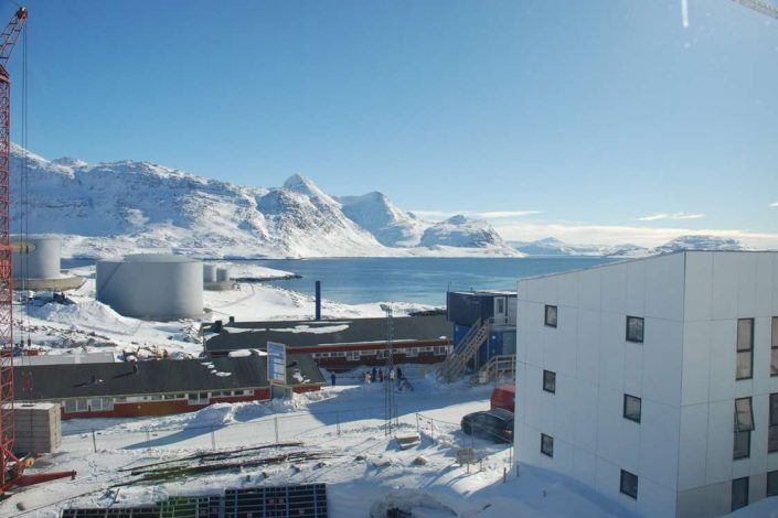 View over parts of Nuuk and a fjord. Photo by Vandrehuset.com, Visit Greenland