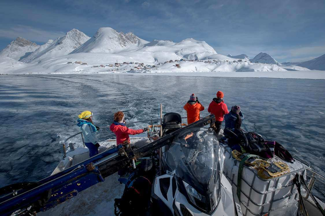 Skiers leaving Kuummiut on the Siggi Turs shuttle boat in East Greenland. Photo by Mads Pihl, Visit Greenland